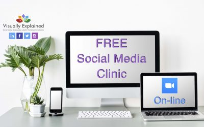 white desk-plant-mobile phone-desktop showing free social media clinic image-laptop displaying online wording
